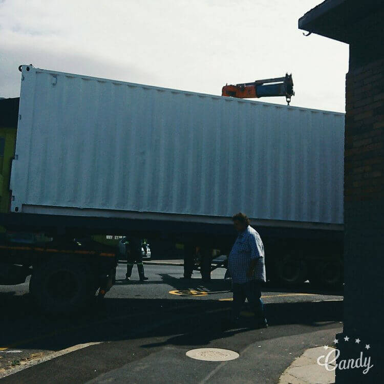 Truck Carrying Shipping Container | Container Rental & Sales 516
