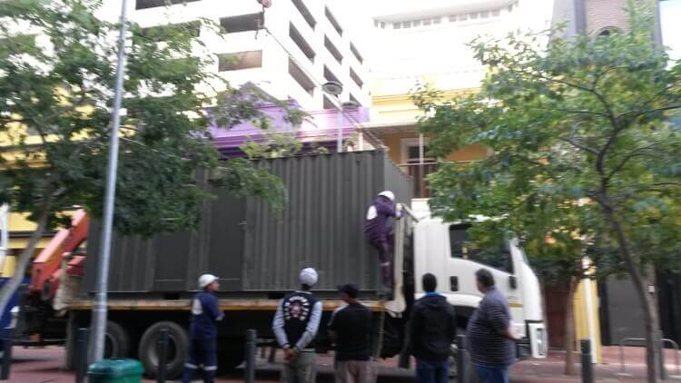 Shipping Container On A Truck About To Be Loaded   Container Rental & Sales