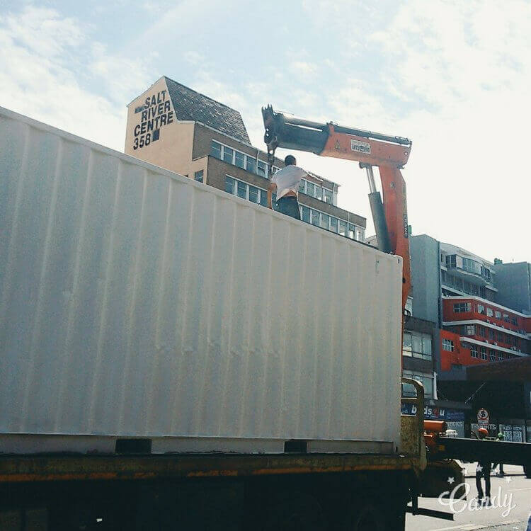 White Shipping Container On A Truck | Container Rental & Sales