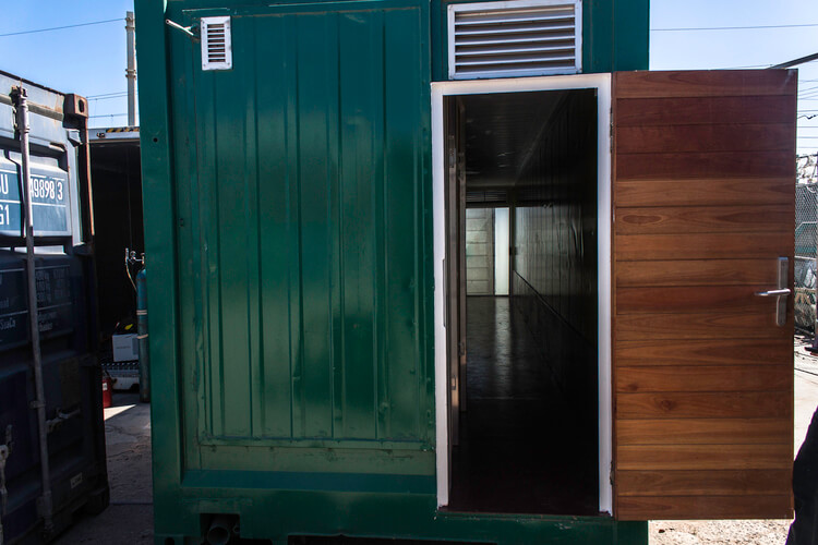 Green Container With Open Wooden Door | Container Rental & Sales