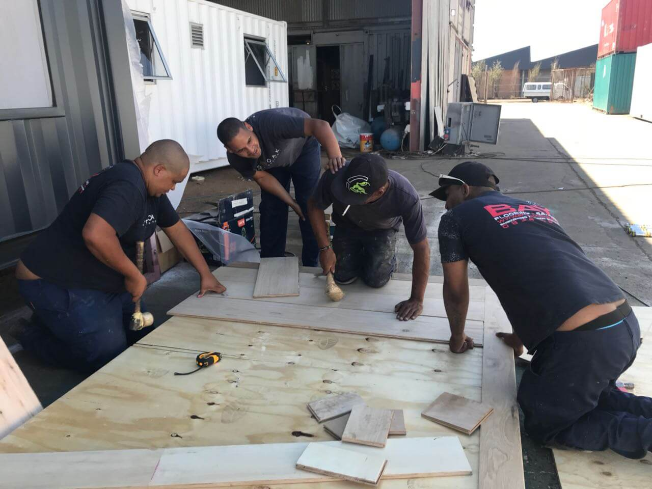 Workers Creating A Wooden Roof | Container Rental & Sales