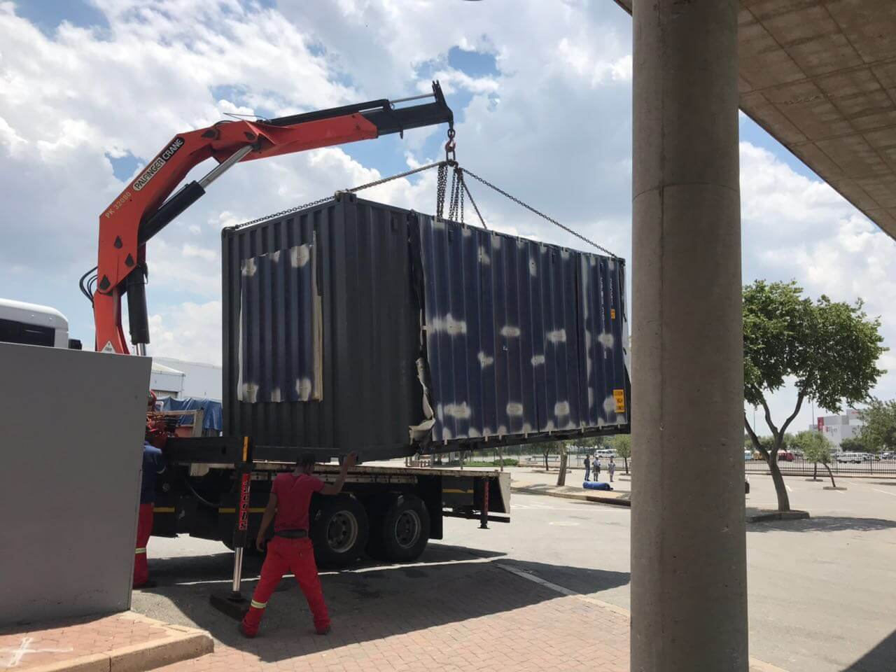 Placing A Container On A Truck | Container Rental & Sales