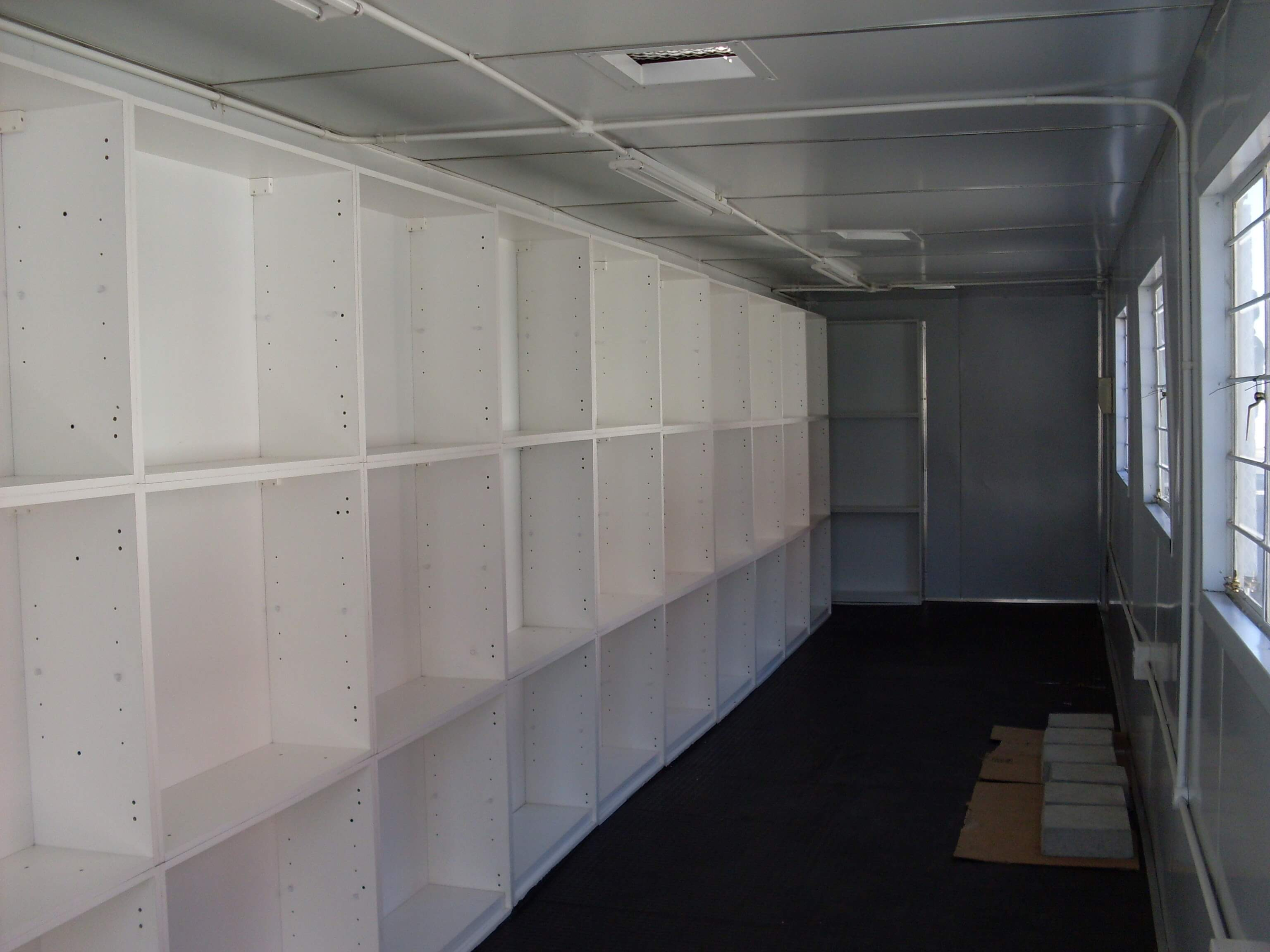 White Wooden Fitted Shelves | Container Rental & Sales