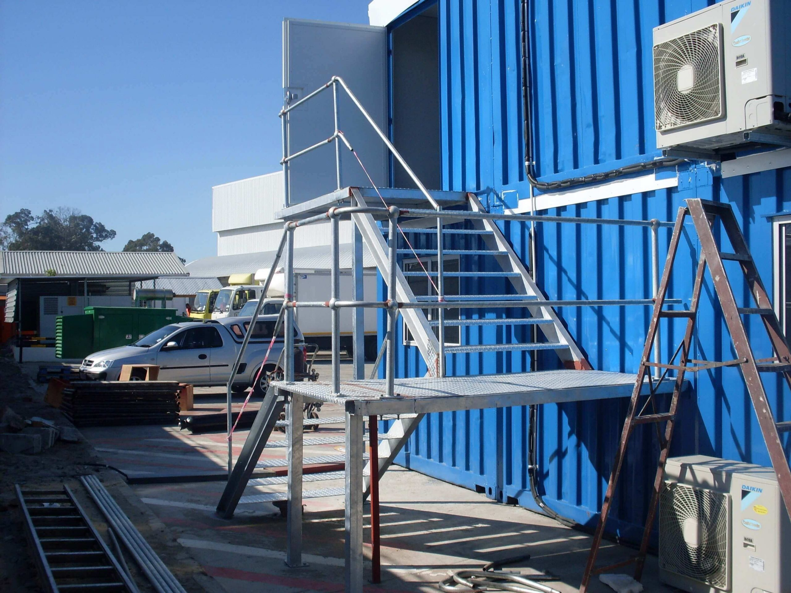 Blue Container With A Ladder And Outdoor Aircon | Container Rental & Sales