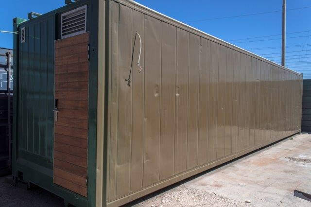 Green Container With Closed Wooden Door | Container Rentals & Sales 108